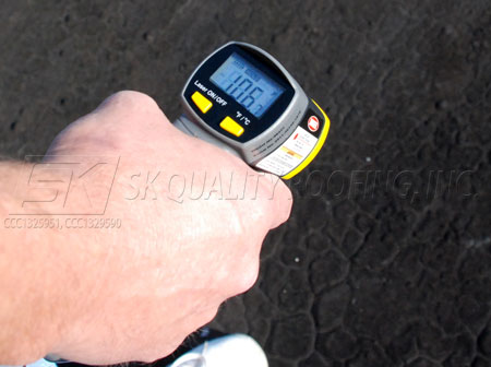 Infrared Thermometer on Asphalt 106 Degrees, before roof coating